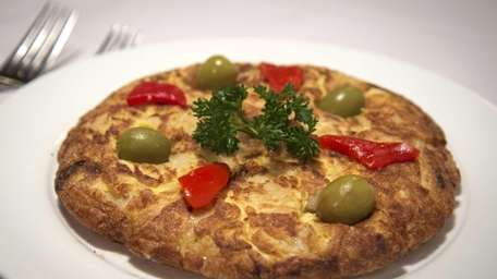 Tapas dishes include tortilla Espanola, a Spanish frittata