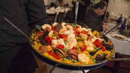 Paella Valenciana, which comes with clams, mussels, shrimp,