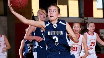 Huntington guard Mackenzie Maloney grabs a loose ball