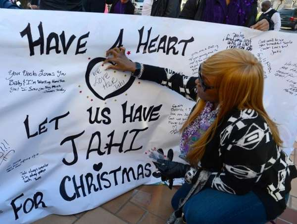 Dede Logan of Oakland, Calif., decorates a poster