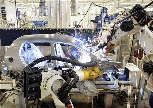 Industrial robots weld the body of a Volkswagen