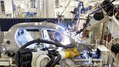 Industrial robots weld the body of a Volkswagen