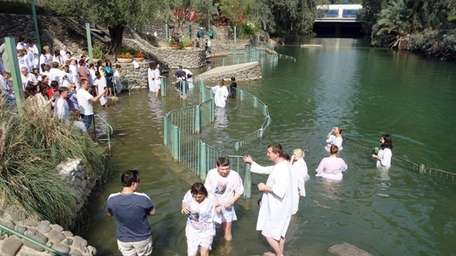 Christians from around the world come to Yardenit