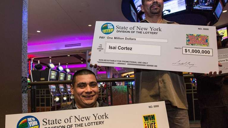 Present with a over-sized prize checks for $1,000,000
