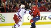 Washington Capitals right wing Alex Ovechkin battles for