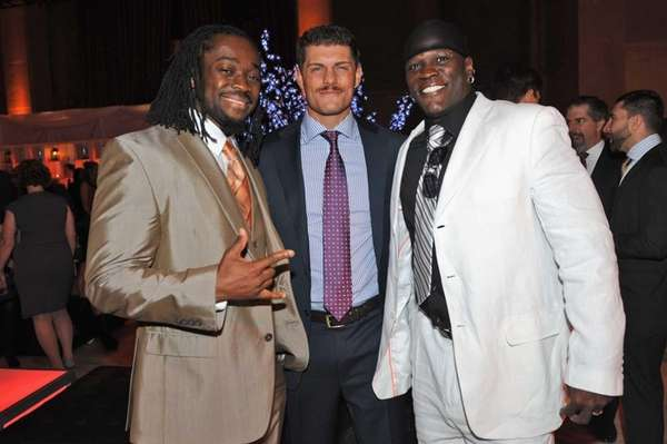 Cody Rhodes, center, with Kofi Kingston, left, and