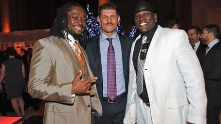 Cody Rhodes, center, with Kofi Kingston, left, and