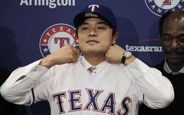 Shin-Soo Choo adjusts the collar of his Texas