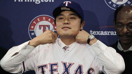 Shin-Soo Choo adjusts the collar of his Texas