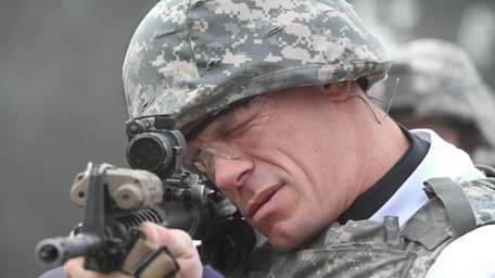 WWE superstar John Cena sights in with an