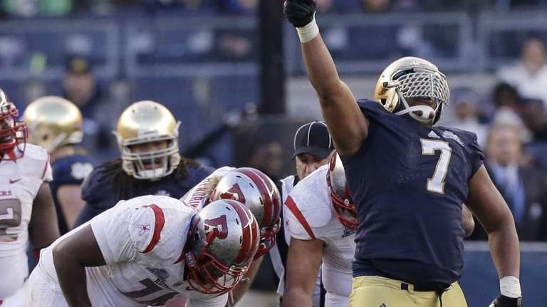 Notre Dame's Stephon Tuitt celebrates a sack on
