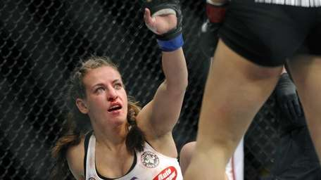 Miesha Tate gestures to Ronda Rousey during the