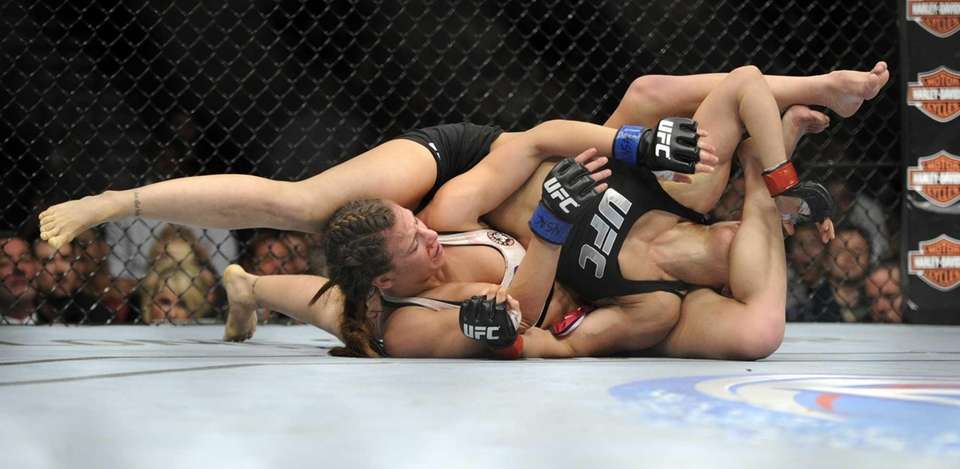 Miesha Tate and Ronda Rousey battle it out