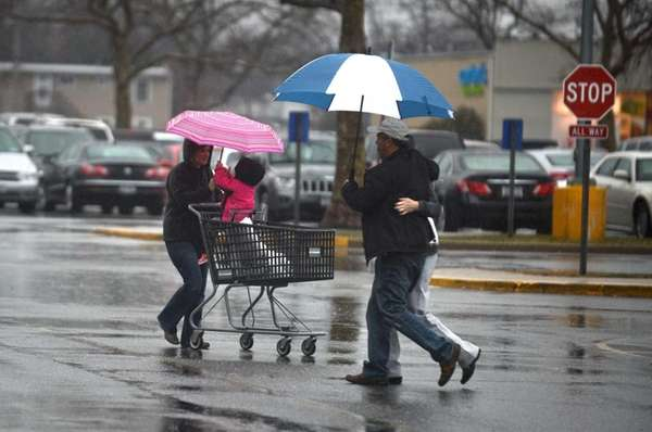 Shoppers walk to their cars in the Great