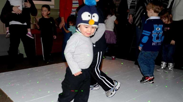 Wearing a penguin hat with a penguin face,
