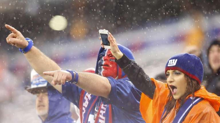 Fans of the New York Giants cheer on