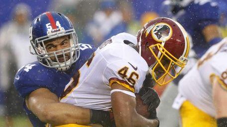 Spencer Paysinger tackles Washington Redskins running back Alfred