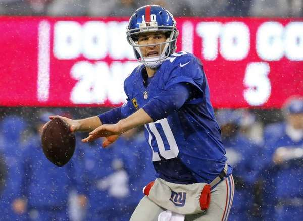 Eli Manning looks to pass the ball against
