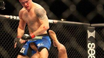 UFC middleweight champion Chris Weidman defeats Anderson Silva
