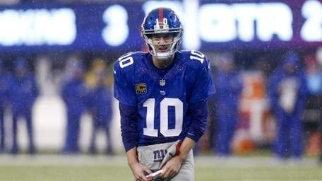 Eli Manning looks at an official during a