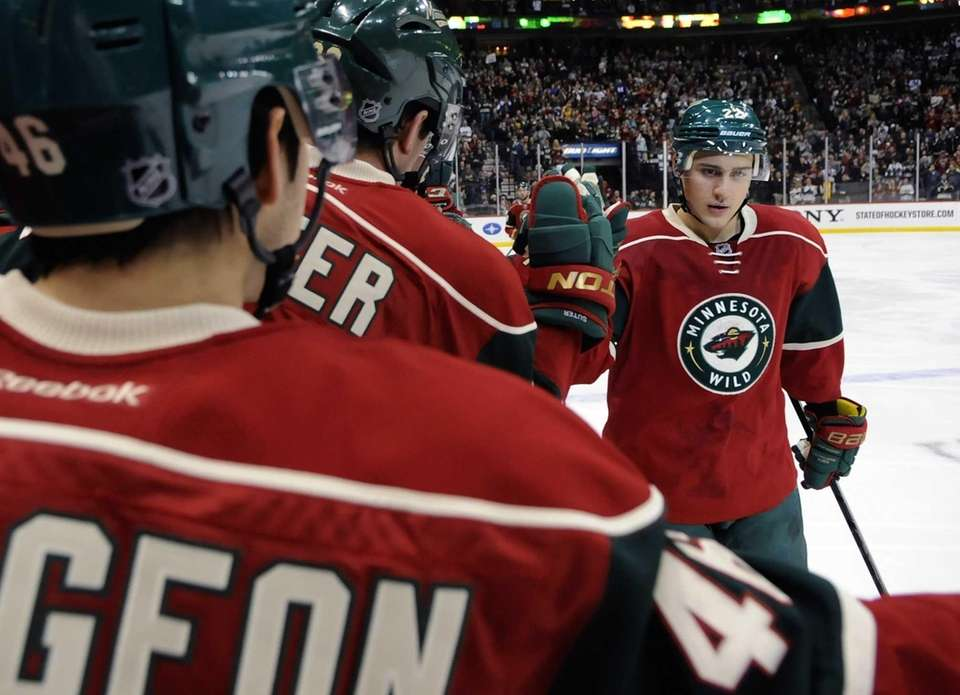 Nino Niederreiter #22 of the Minnesota Wild celebrates