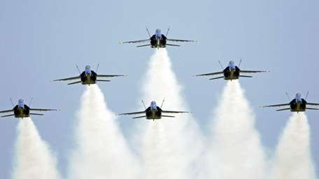 The U.S. Navy Blue Angels demonstration squadron flies