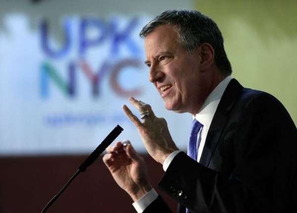 New York Mayor-elect Bill de Blasio delivers his