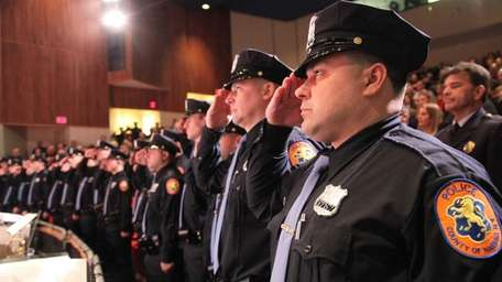 Afredo Rodriguez III, right, along with other recruits,
