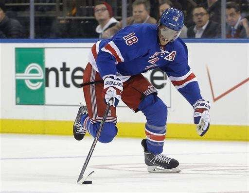 Marc Staal skates with the puck during the