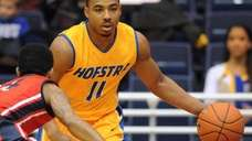 Hofstra's Dion Nesmith looks to dribble around defensive
