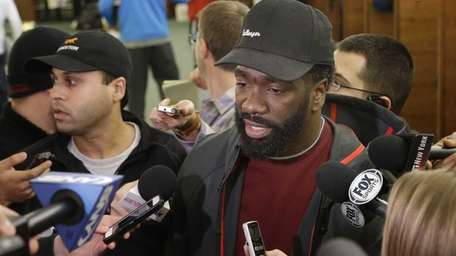Ed Reed speaks to reporters in the locker