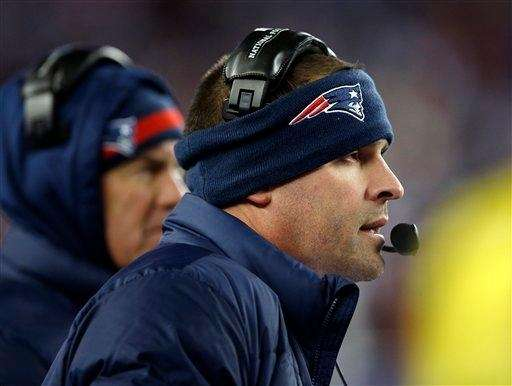 New England Patriots offensive coordinator Josh McDaniels watches