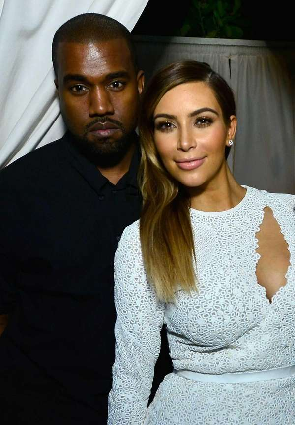 Kanye West and Kim Kardashian attend a DuJour
