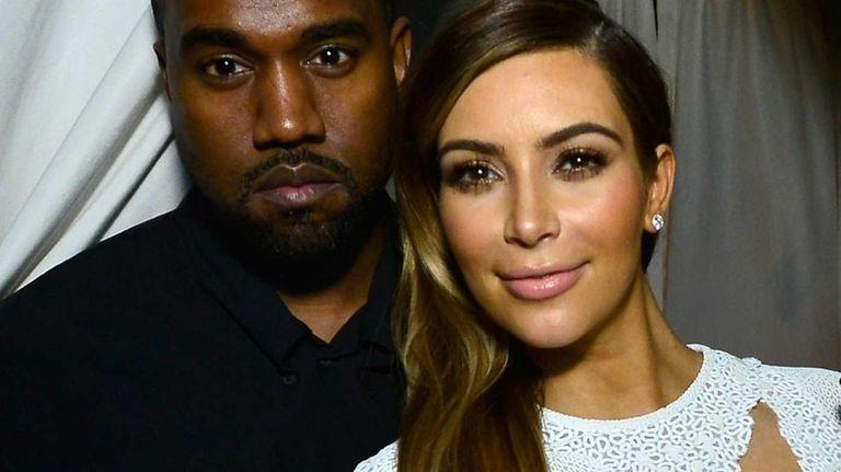 Kanye West and Kim Kardashian attend a DuJour