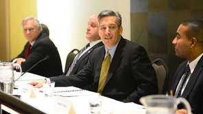 NIFA Chairman Jon Kaiman, center, during a meeting