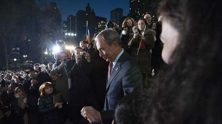 New York City Mayor Michael Bloomberg is cheered