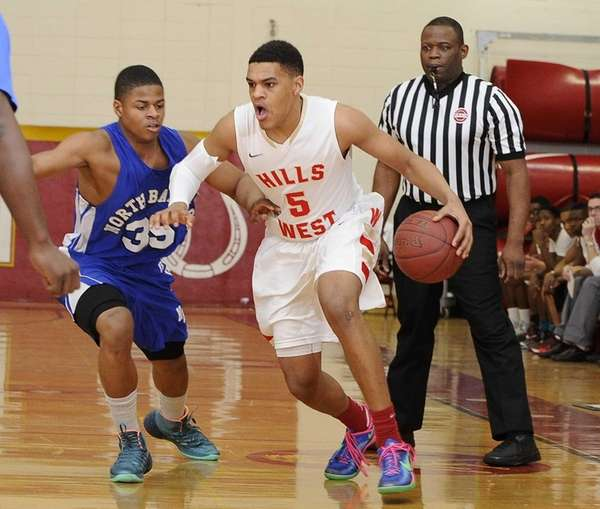 Half Hollow Hills West guard Terry Harris drives