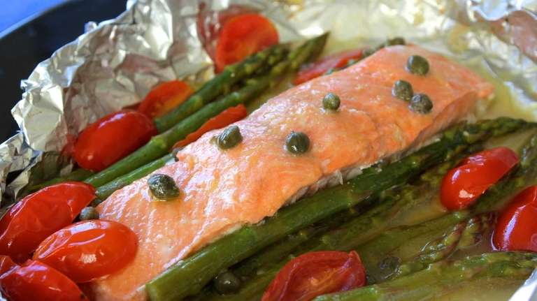 Salmon, asparagus and grape tomatoes en papillote. (January