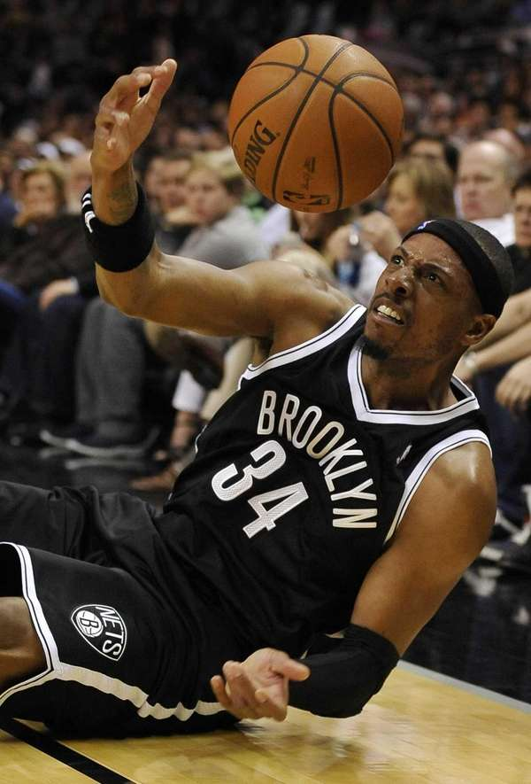 Nets forward Paul Pierce slides out of bounds