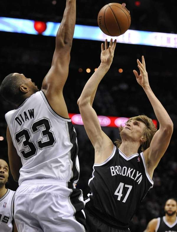 Nets forward Andrei Kirilenko, right, shoots against San