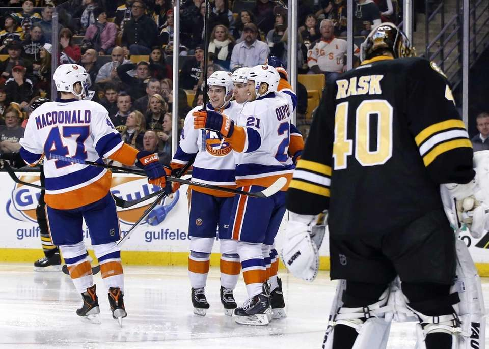 Boston Bruins goalie Tuukka Rask reacts as Islanders