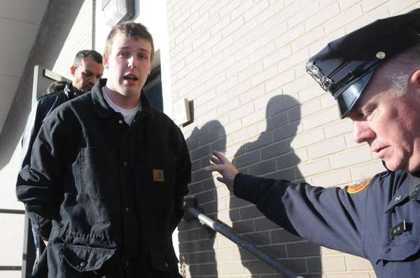 James Murphy, 19, of Huntington, is led out