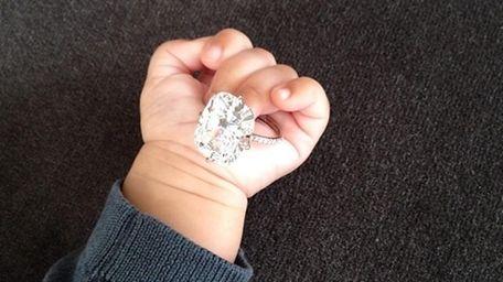 Baby North West clutches mama Kim Kardashian's 15-carat