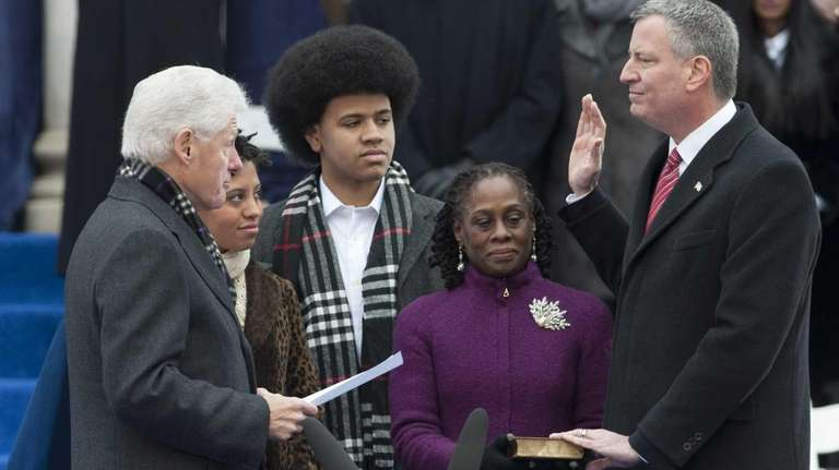Former President Bill Clinton administers the oath to