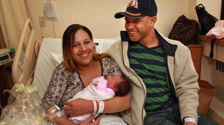 Jacqueline Rodriguez and Enerio Almonte, of Massapequa, hold