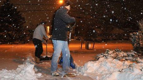 Men shovel outside Faith Evangelical Lutheran Church in