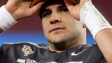 Central Florida quarterback Blake Bortles puts on his
