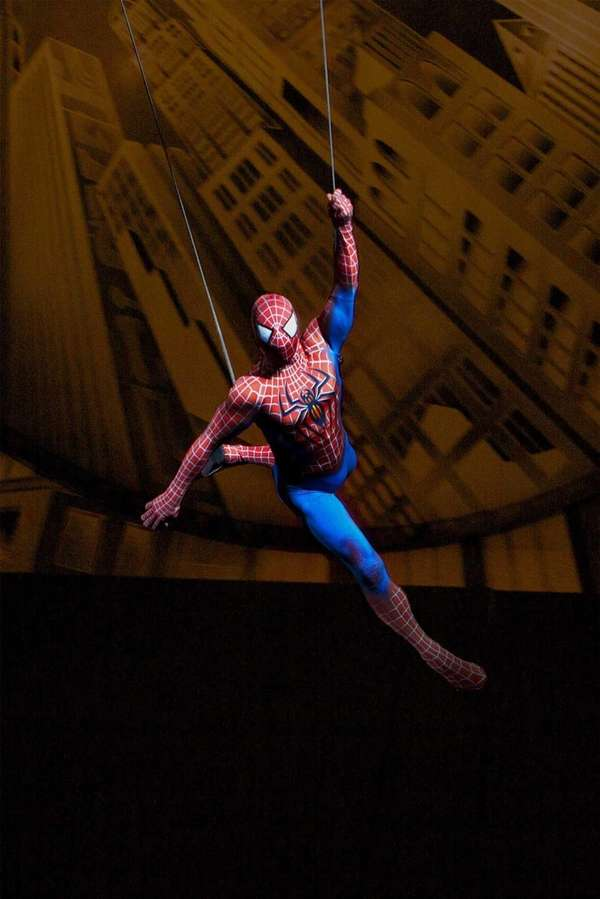 Spider-Man flies through the Foxwoods Theatre in a