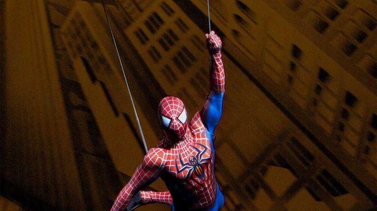 Spider-Man flies through the Foxwoods Theatre in a