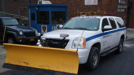 A service truck sits with plow at the